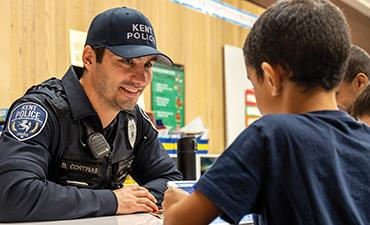 Kent Police Officer with students