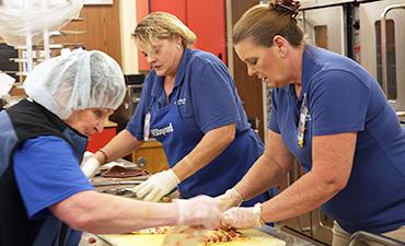 Nutrition Services staff preparing meals
